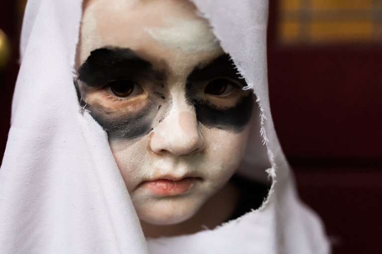 boy dressed as ghost - family documentary photography