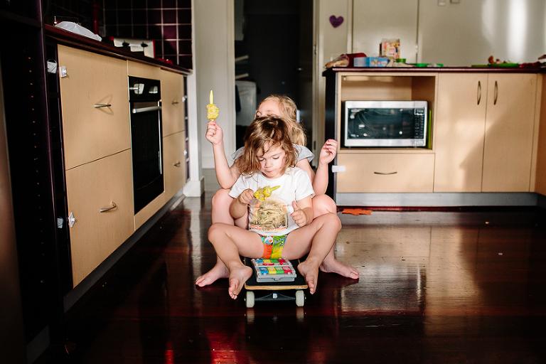 kids eating corn on skateboard - family documentary photography