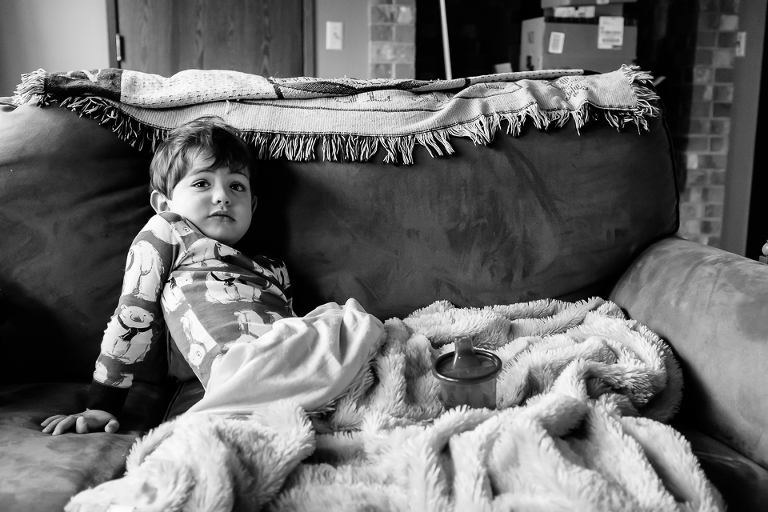 boy lounges on couch - Family Documentary Photography