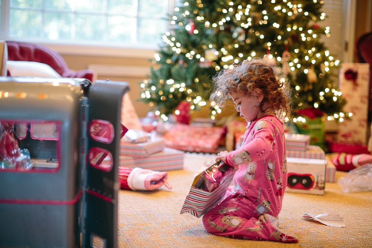 Girl opens present - Family Documentary Photography