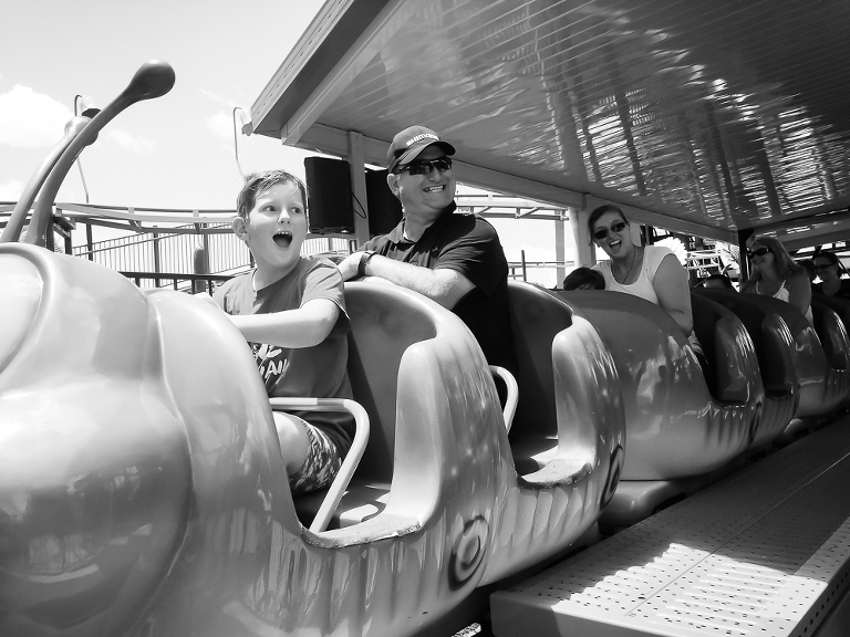 Family in roller coaster cars - Documentary Family Photography