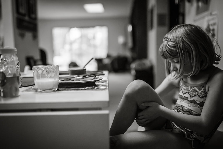 Girl at breakfast table - Documentary Family Photography