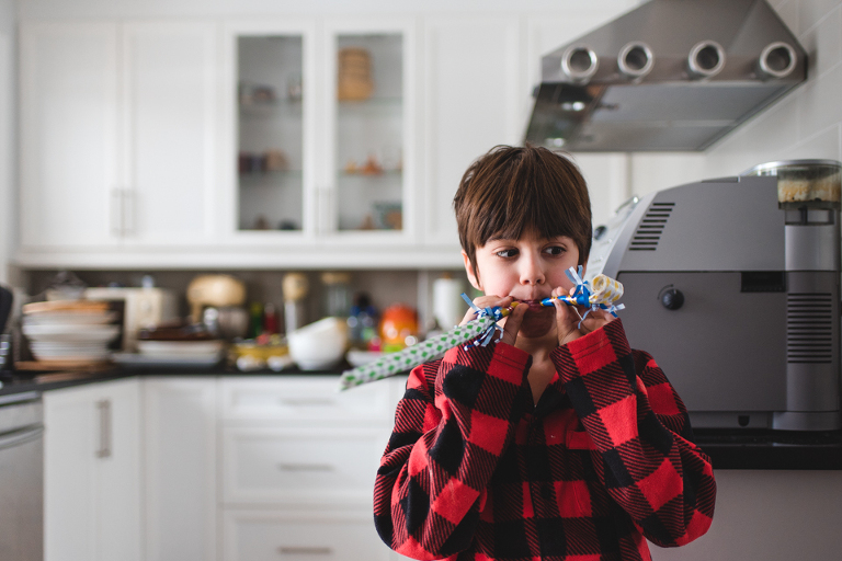 boy with party noisemakers - Documentary Family Photography