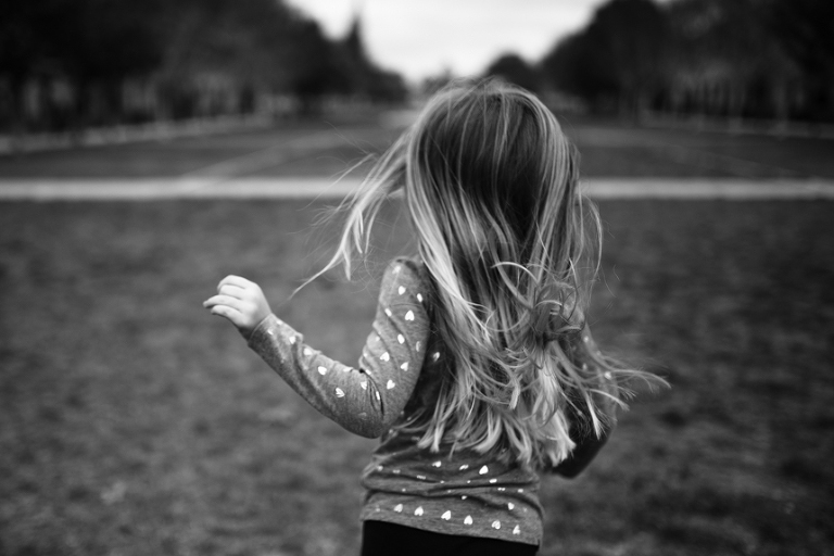 girl with long hair running - Documentary Family Photography