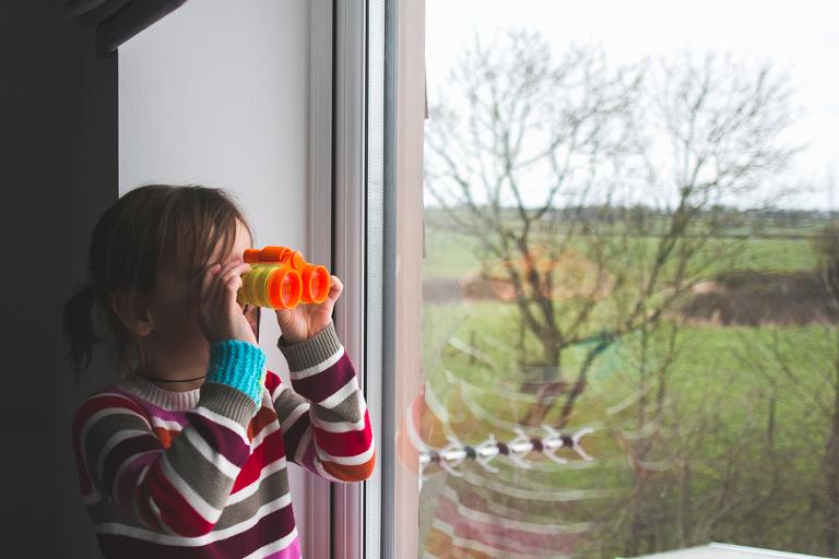 Girl with binoculars - Documentary Family Photography