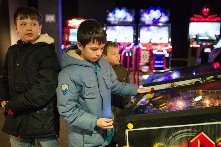 boys at arcade - Documentary Family Photography