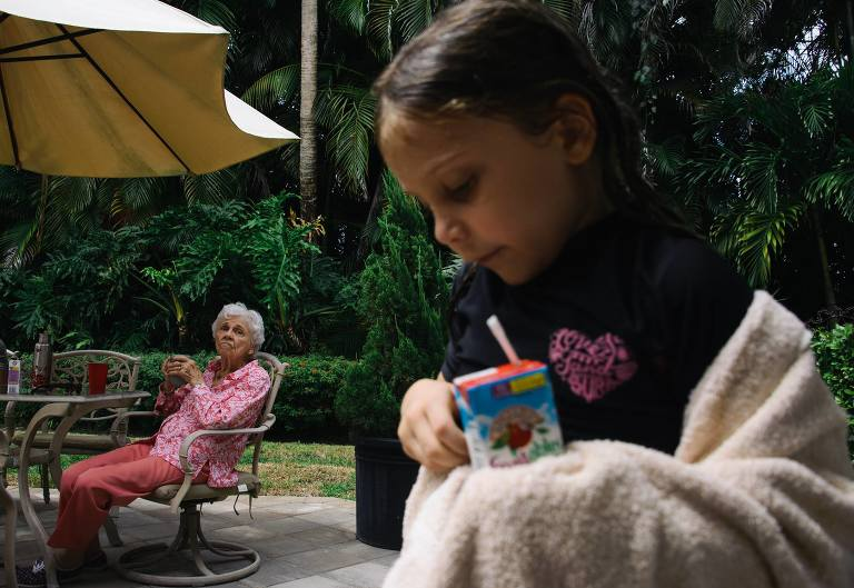 grandmother watches girl walk by at pool - Documentary Family Photography