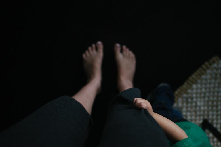 child holding mom's pant leg - Documentary Family Photography