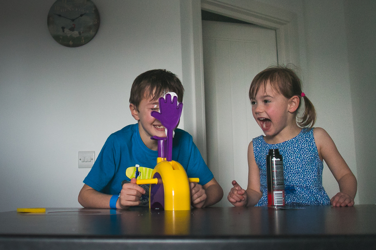 kids playing pie in the face game - Documentary Family Photography