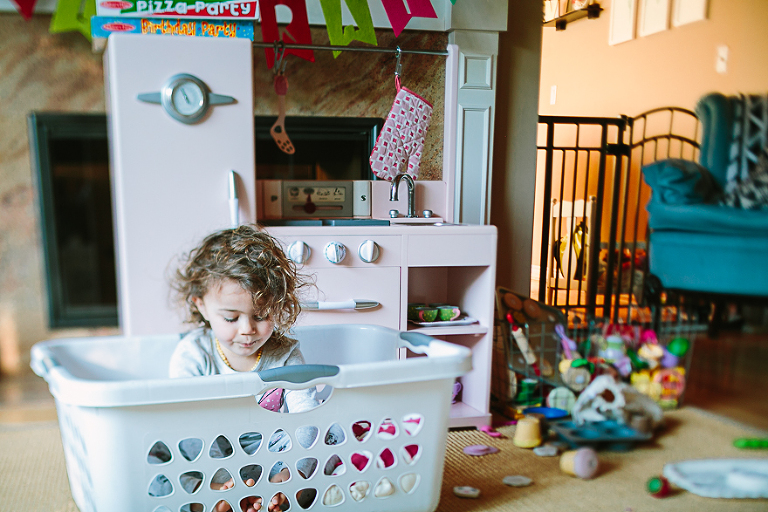 girl in laundry basket - Documentary Family Photography