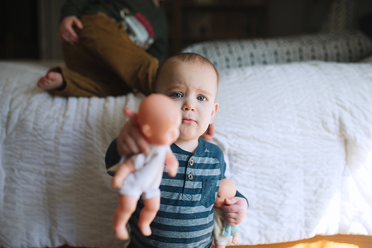 baby with baby doll - Documentary Family Photography