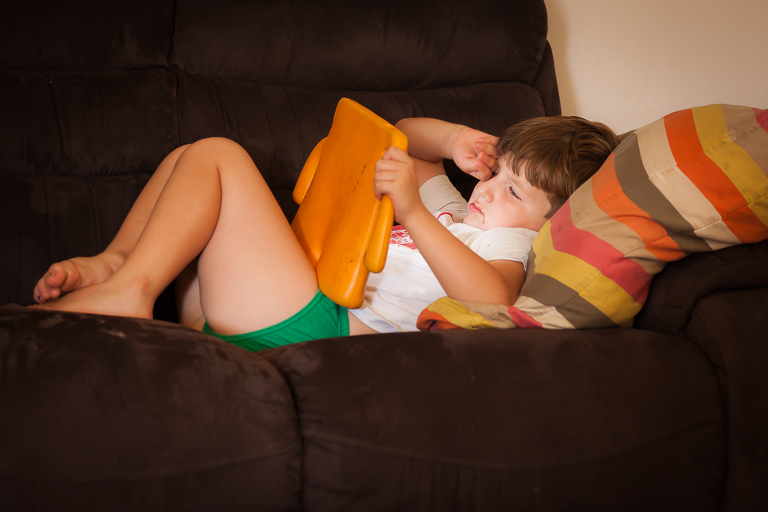 boy with tablet on couch - Documentary Family Photography