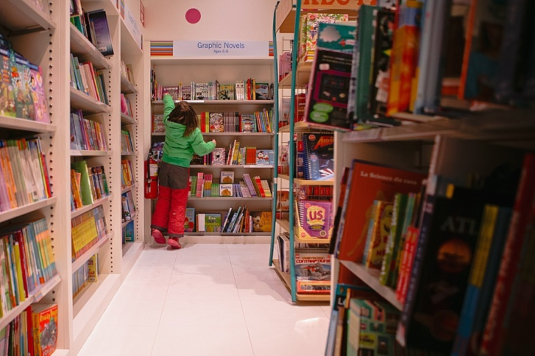 girl in coat at library - Documentary Family Photography