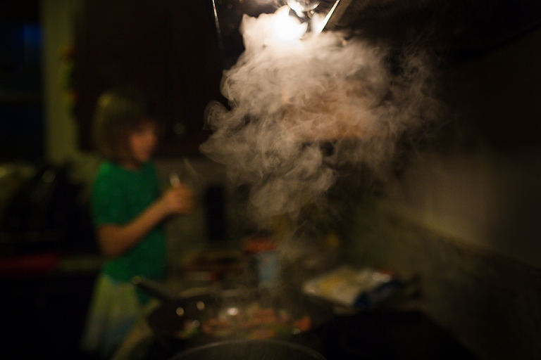 girl at steaming pot - Documentary Family Photography