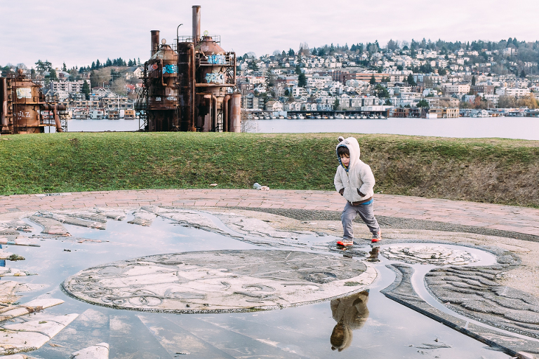 boy jumping over puddle -Documentary Family Photography