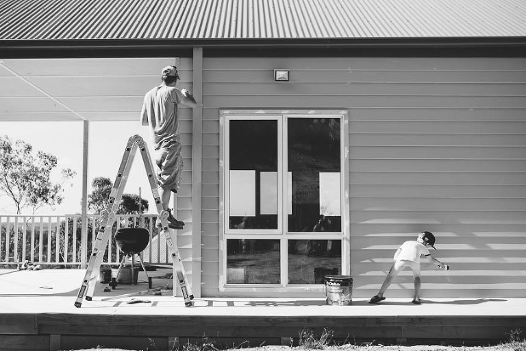 man and child do exterior house painting - Documentary Family Photography