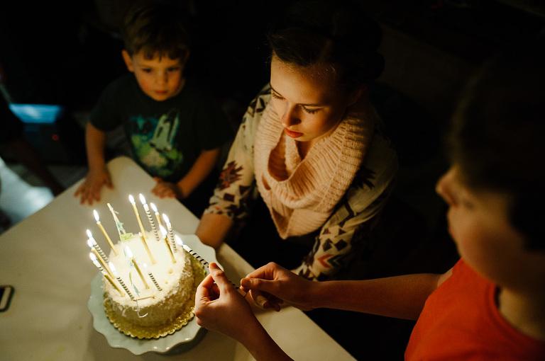 Girl with birthday cake - Documentary Family Photography