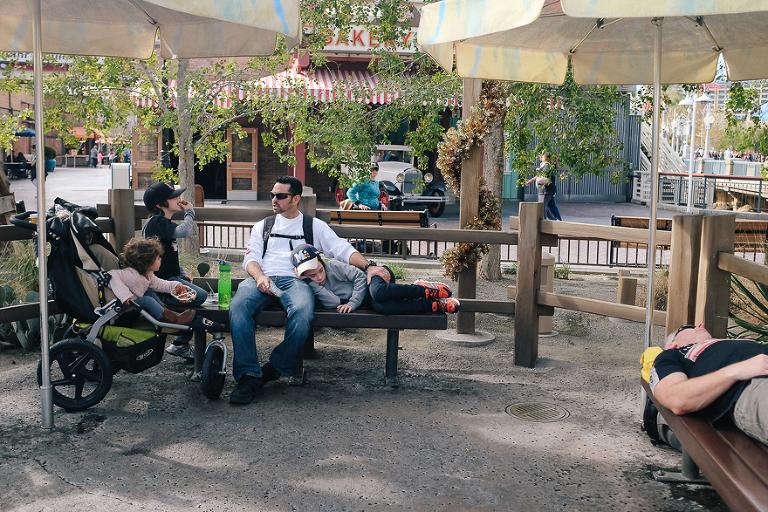 family gathered around park bench - Documentary Family Photography