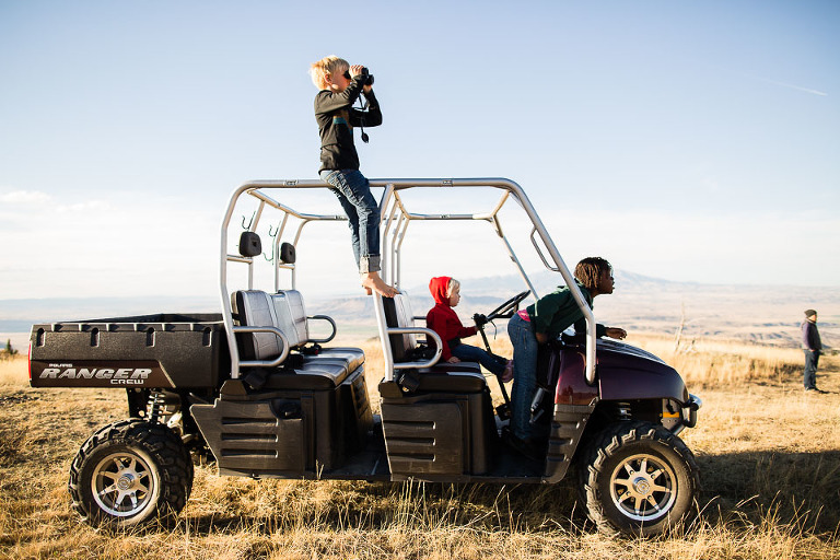 children in jeep on African Plains