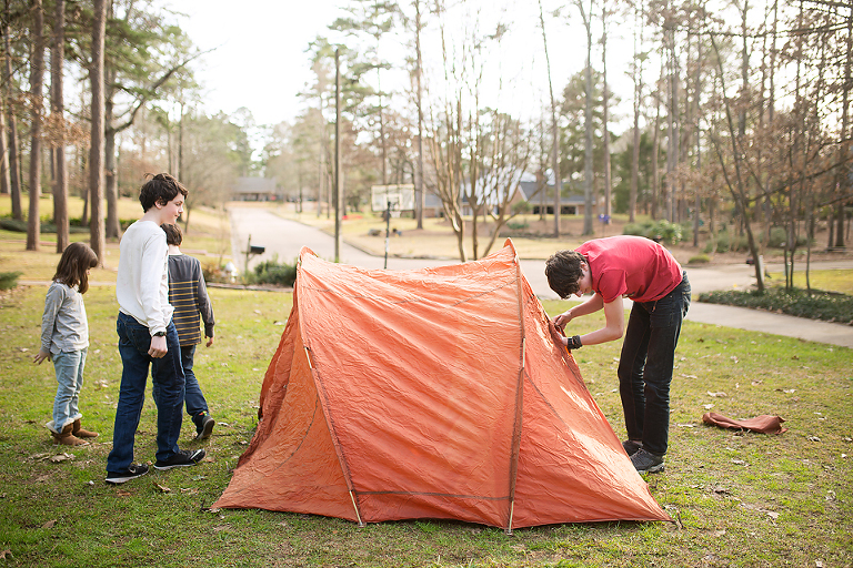 Family putting up tent - Documentary Family Photography