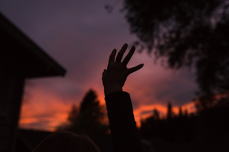 silhouette of hand in air at sunset- Documentary Family Photography