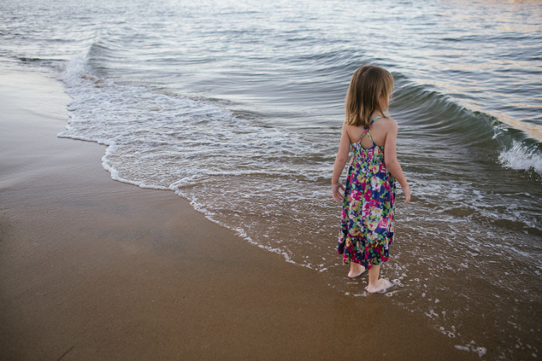 girl standing on ocean shore - Documentary Family Photography