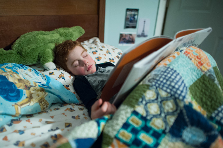 boy falls asleep while reading - Documentary Family Photography