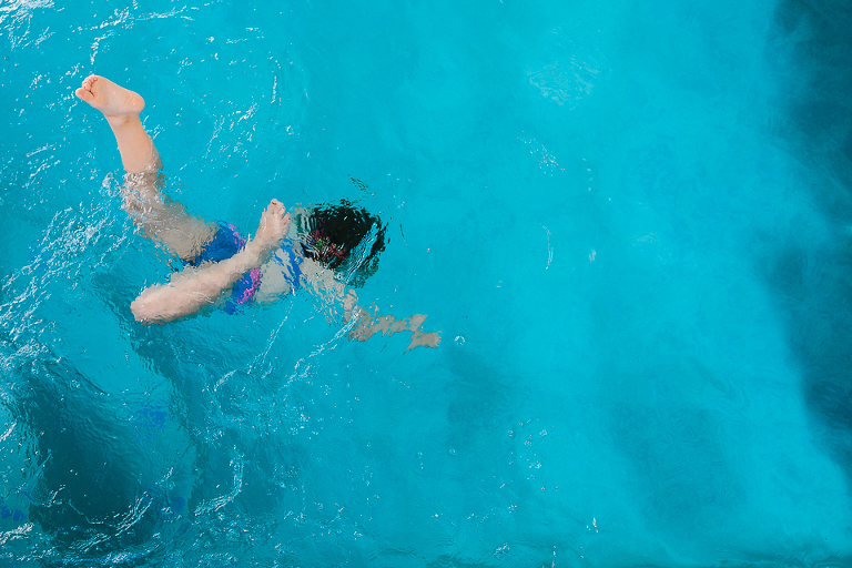 child jumps in pool - Documentary Family Photography