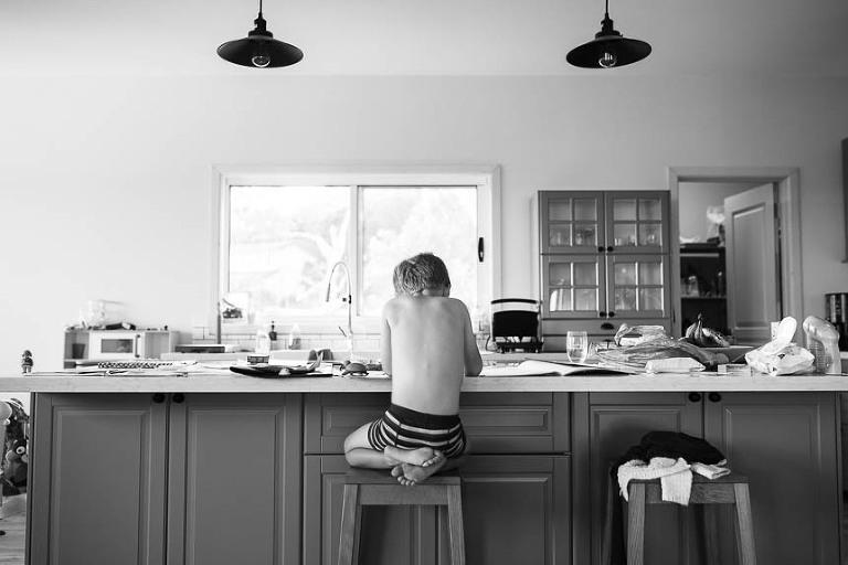 boy sitting at counter -Documentary Family Photography