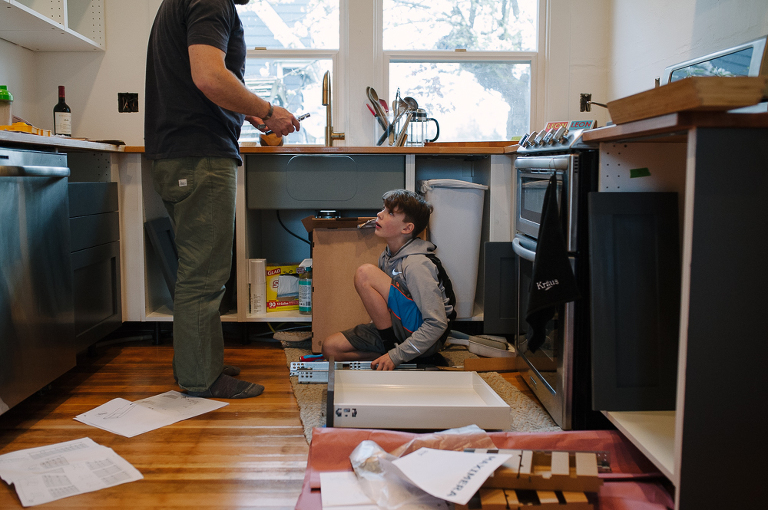 father and son with kitchen remodel - Documentary Family Photography