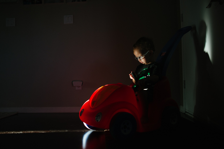Little boy plays in shadows - Documentary Family Photography