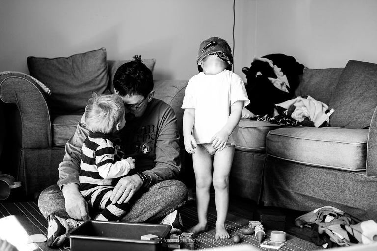 bored boy with underwear on head - Documentary Family Photography