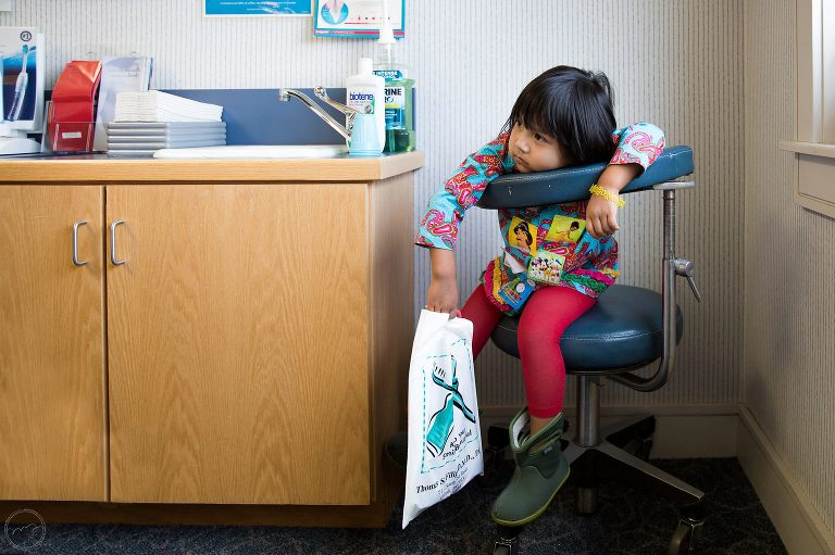 girl waits in dentist office - Documentary Family Photography