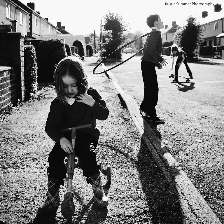 kids play on street in sunshine - Documentary Family Photography