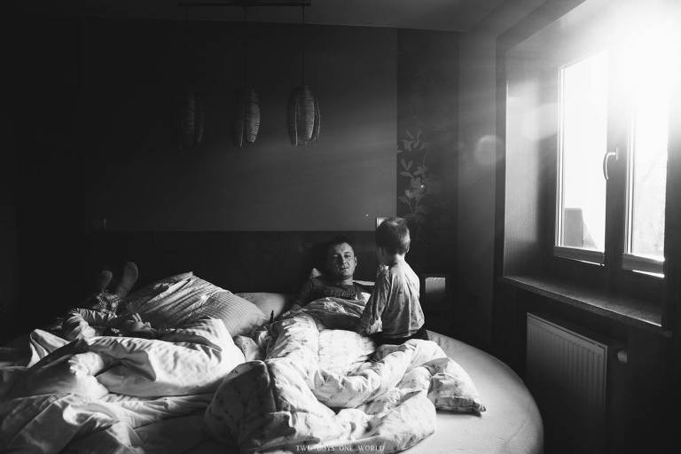 kids in bed with father - Documentary Family Photography