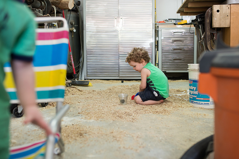 boy with cup and sawdust - documentary family photography