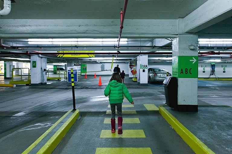 girl on cross walk in parking garage - documentary family photography