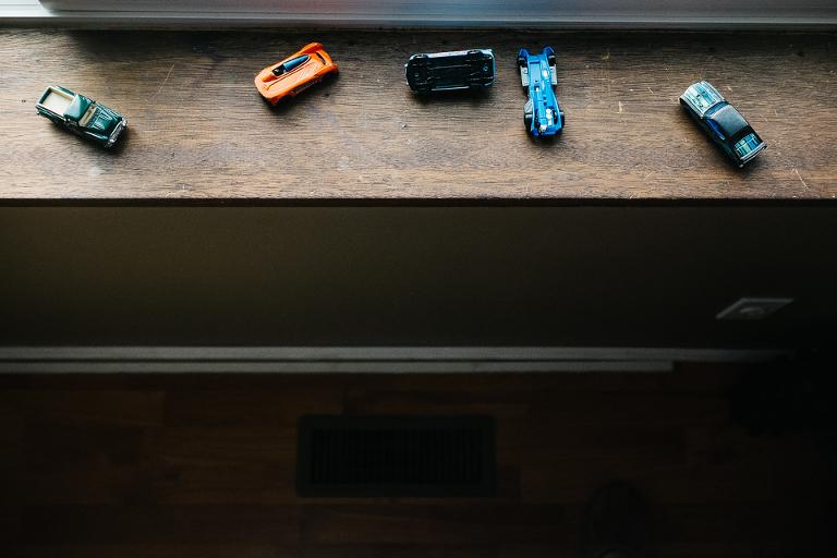 toy cars on windowsill - documentary family photography