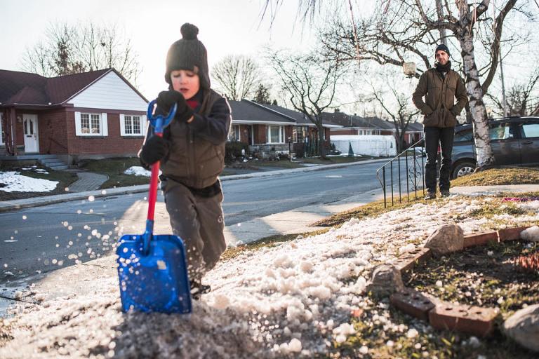child shoveling snow - documentary family photography