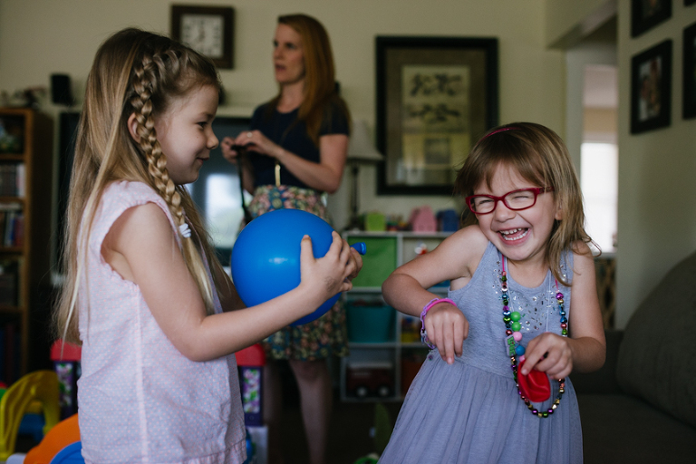 girls laughing at birthday party - documentary family photography