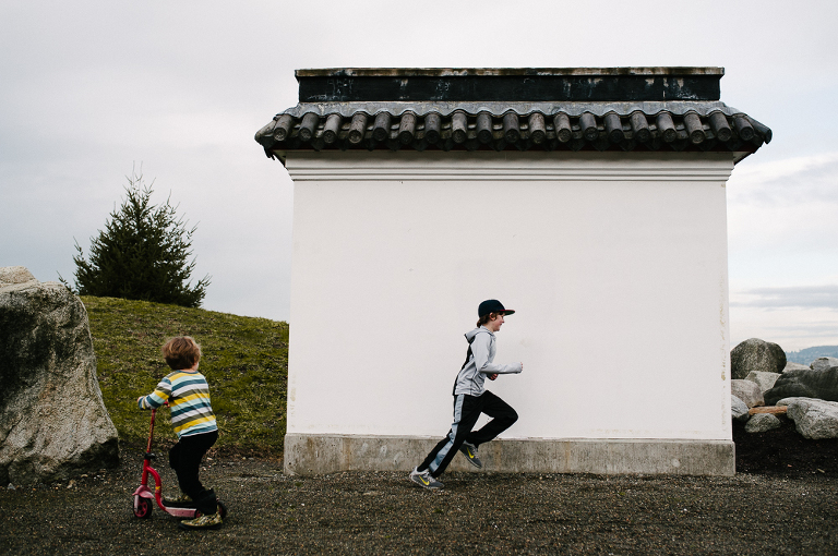 boys running near out building - documentary family photography