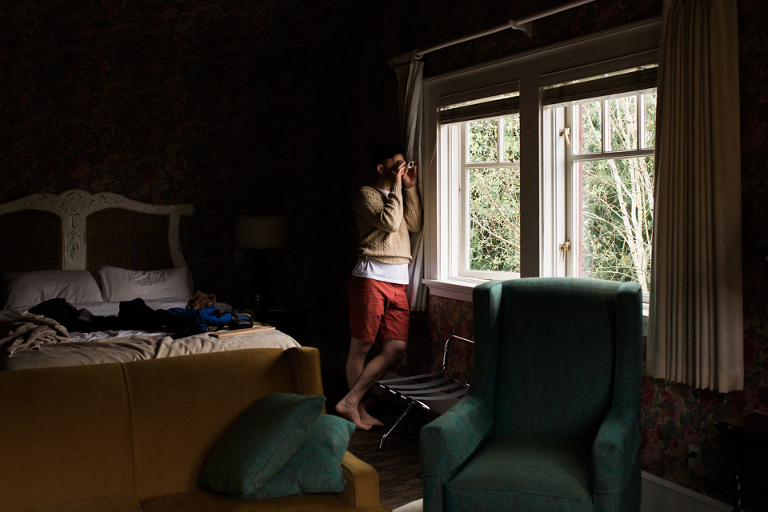 man with binoculars at window -Documentary Family Photography