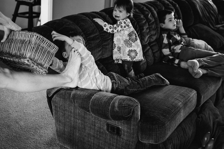 kids throw fit on couch - Documentary Family Photography