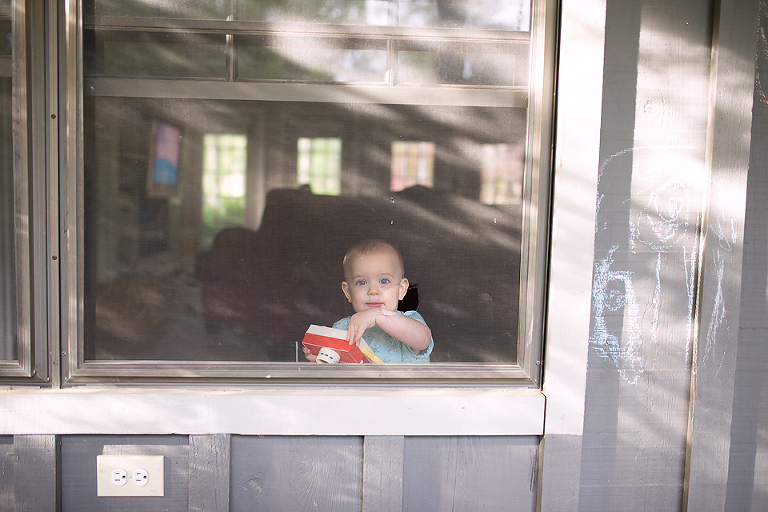 baby in window -Documentary Family Photography