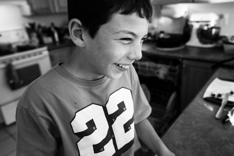 boy laughing - Documentary Family Photography