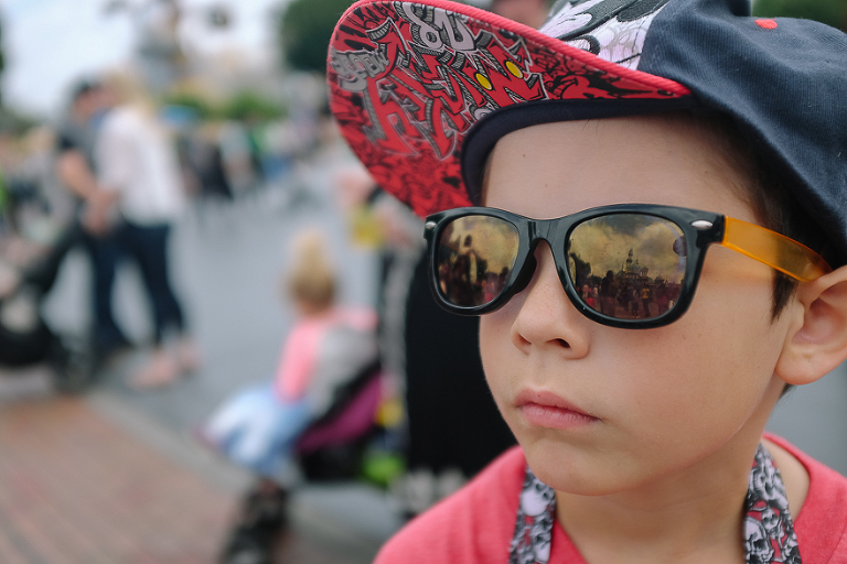 Child in hat and sunglasses - Documentary Family Photography
