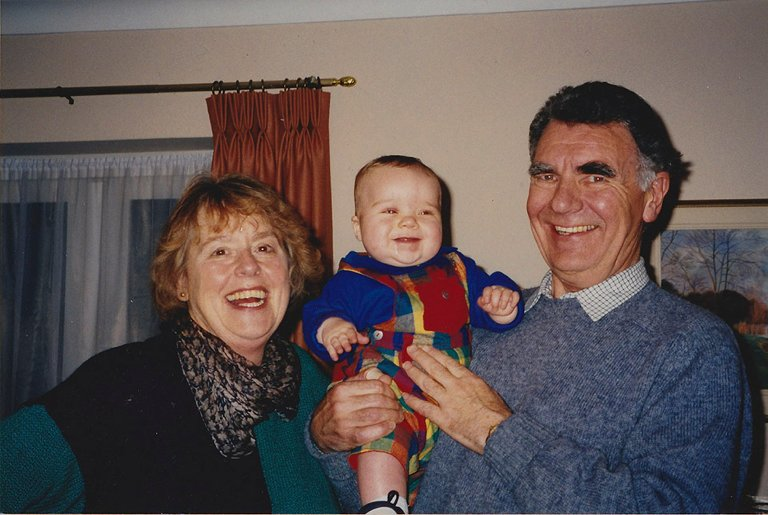 snapshot of grandparents with grandchild - Documentary Family Photography