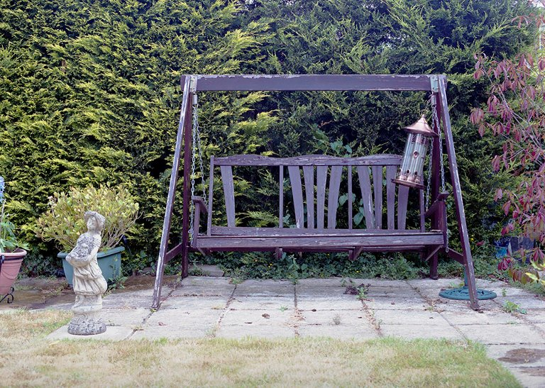 broken patio swing - Documentary Family Photography