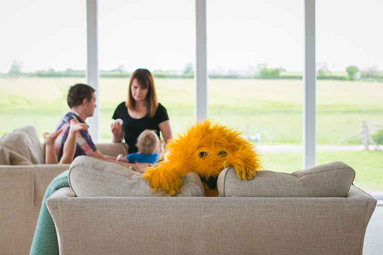toy monster on couch - Documentary Family Photography