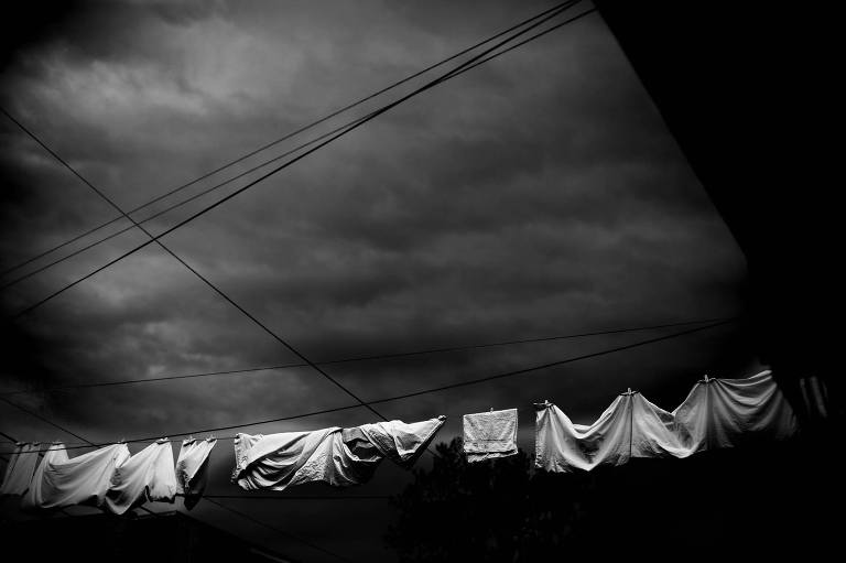 laundry drying on line before storm - Documentary Family Photography